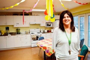 Linda Fox, site program manager for the Yukon Shelter in Vancouver, shows off a common room in the facility's transitional housing space. The room, available to those staying in the supported housing, is often used for community events and birthday parties. (Photo: AMY REID)