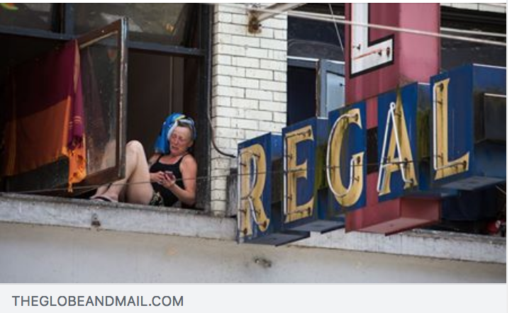 A woman sits on a window terrace at the Sahota-owned Regal Hotel. BEN NELMS/THE GLOBE AND MAIL