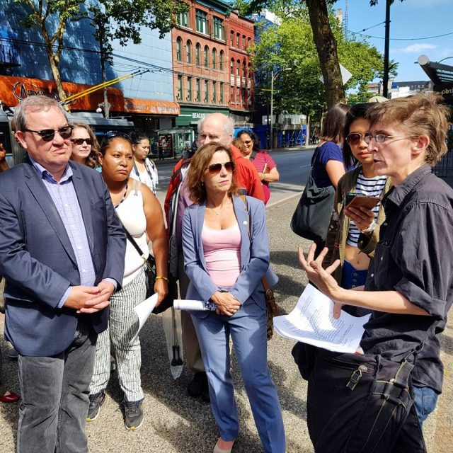 Shortly after being appointed to cabinet, Poverty Reducation Minister Shane Simpson (left) and Municipal Affairs and Housing Minister Selina Robinson (centre) went on a tour of the Downtown Eastside