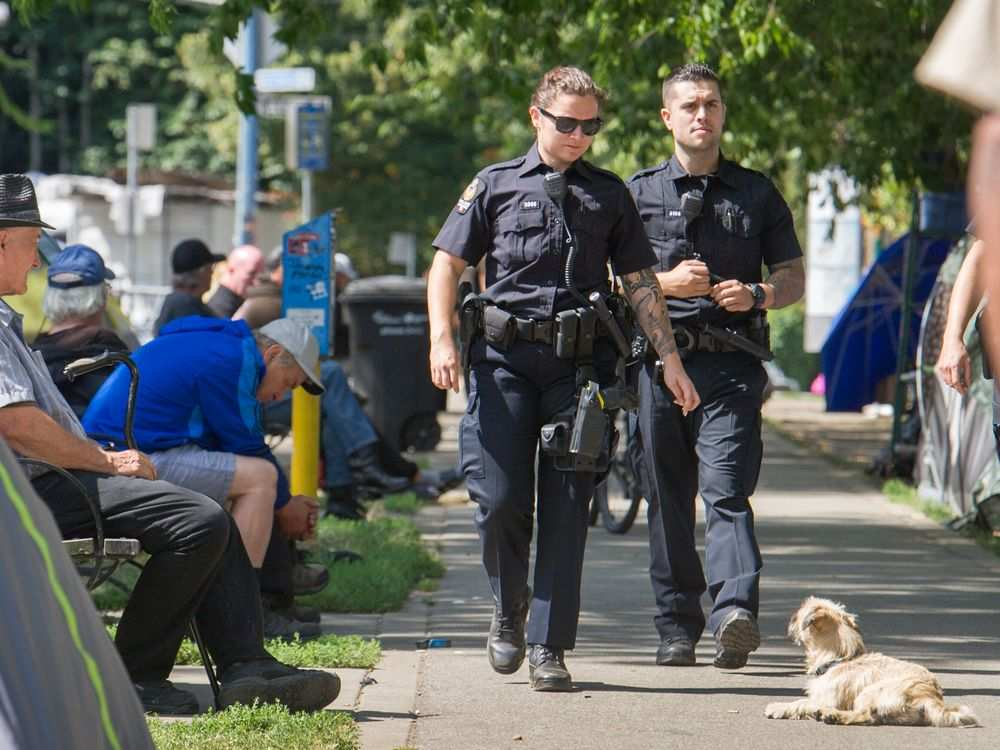 Vancouver police presence was evident at Oppenheimer Park on Monday morning as campers there were being told they would have to leave by Wednesday evening. Arlen Redekop / PNG
